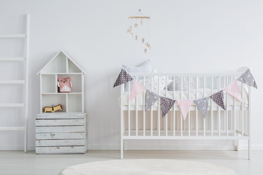 White, vintage baby furniture set in scandi room